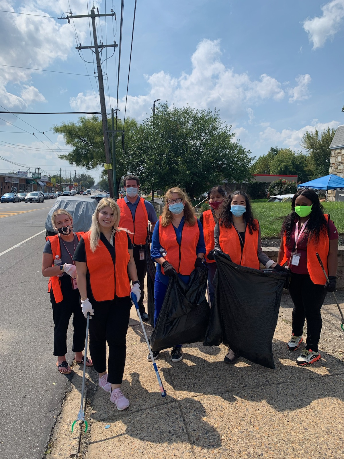 Credit Union volunteers pick up along Frankford Avenue.